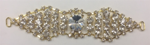 BKL-RHS-017-GOLD. Clear Crystals on Gold Metal Applique / Buckle - 5 X 1.2 Inches. Has hooks at booth ends. Very versatile accessory on garments and swim-suits.