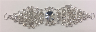 BKL-RHS-017-SILVER. Clear Crystals on Silver Applique / Buckle - 5 X 1.2 Inches. Has hooks at booth ends. Very versatile accessory on garments and swim-suits.  BKL-RHS-017-plata. hebilla/aplicacion de cristal claro con diamante imitacion - 5 X 1.2 pulgada