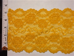 LST-REG-621-MUSTARD.  STRETCH LACE 6 INCH WIDE - MUSTARD