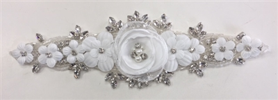 RHS-APL-006-SILVER. Hot-Fix / Sew-On Clear Crystal Rhinestone Applique - 9 x 3 Inches. Made with high quality clear crystals, Beads, Pearls and flowers with a layer of hot-fix glue on the back.