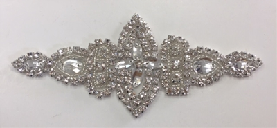 RHS-APL-007-SILVER. Hot-Fix / Sew-On Clear Crystal Rhinestone Applique - 6 x 2.5 Inches. Made with high quality clear crystals, Beads, and with a layer of hot-fix glue on the back.