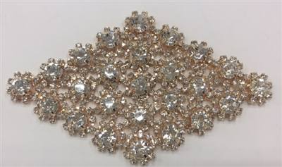 RHS-APL-M132-ROSEGOLD. Clear Rhinestones on Rose-Gold Metal Applique. 4 x 2.5 Inches