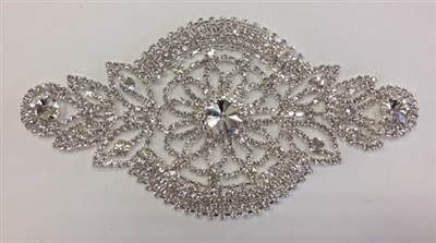 RHS-APL-M222-SILVER. Glue-On or Sew-On Clear Crystal Rhinestones on Silver Metal Applique - 7 x 4 Inches. Can be Used for Making Belts, Sashes, Head-Bands, Party Dresses and Costumes.